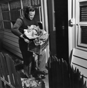 Marlon Brando taking out the garbage at his Beverly Glen home in Los Angeles 1953 © 1978 Sid Avery - Image 0007_0002