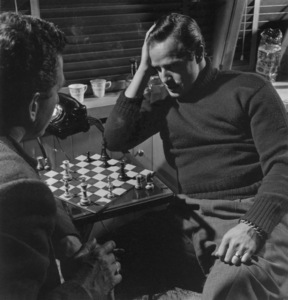 Marlon Brando playing chess in the den of his Beverly Glen home in Los Angeles 1953 © 1978 Sid Avery MPTV - Image 0007_0031