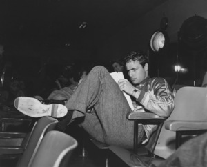 """Marlon Brando on the set of """"A Streetcar Named Desire"""" Studying his lines for the next day"""