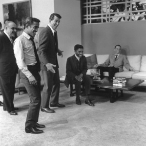 "Akim Tamiroff, Sammy Davis Jr. and Dean Martin staging a fight on the set of ""Ocean"