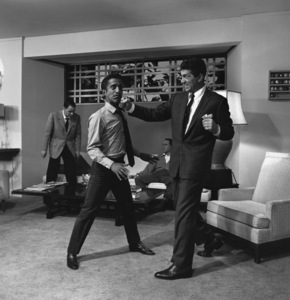 """Sammy Davis Jr. and Dean Martin staging a fight on the set of """"Ocean"""