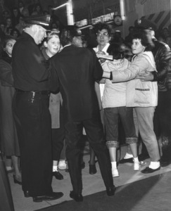 "Sammy Davis Jr. signing autographs at the ""Can Can,"" Premiere, 1960. © 1978 Sid Avery - Image 0009_0164"