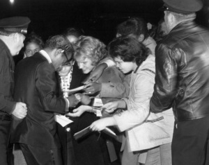 """Sammy Davis Jr. signing autographs at """"Can Can,"""" PRemiere, 1960. © 1978 Sid Avery - Image 0009_0187"""