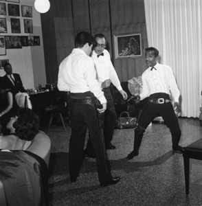 Sammy Davis Jr. practicing his six shooter quick-draw at his Hollywood Hills home with Tommy Sands and Bob Six1960© 1978 Sid Avery - Image 0009_0208