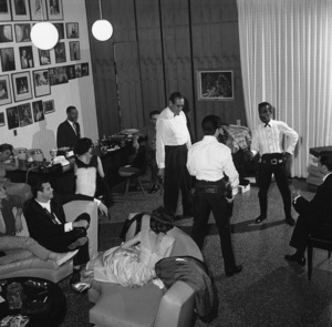 Sammy Davis Jr. practicing his six shooter quick-draw at his Hollywood Hills home with Tommy Sands and Bob Six1960© 1978 Sid Avery - Image 0009_0209