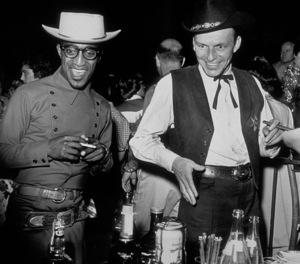 Sammy Davis Jr. and Frank Sinatra at therestaurant Moulin Rouge, c. 1957. - Image 0009_0442