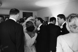 Jack Entratter (back to camera), Frank Sinatra and Peter Lawford at Sammy Davis Jr.