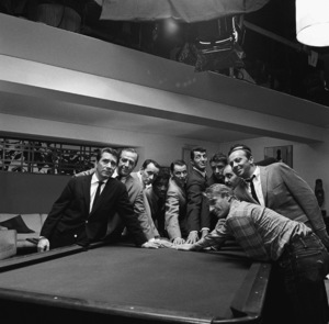 """Sammy Davis Jr. posing around the pool table with Richard Conte, Buddy Lester, Joey Bishop, Frank Sinatra, Dean Martin, Peter Lawford, Richard Benedict, Henry Silva, Norman Fell and Clem Harvey during the making of """"Ocean"""