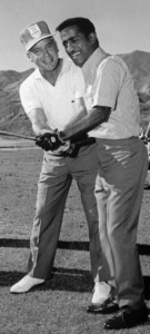 Sammy Davis Jr. and Bo Wininger at the Canyon Country Club in Palm Springs for The Frank Sinatra Invitational Golf Tournament1963Photo by Lester Nehamkin** G.L. - Image 0009_2209