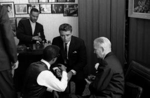 Peter Lawford talking with Sammy Davis Jr. on Sammy and May Britt