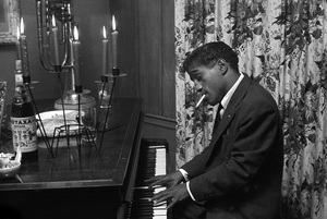 Sammy Davis Jr. playing the piano at a party1955 © 1978 Bernie Abramson - Image 0009_2262