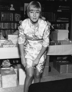 May Britt pulling up her garter on her wedding day to Sammy Davis Jr.11-13-1960 © 1978 Bernie Abramson - Image 0009_2323