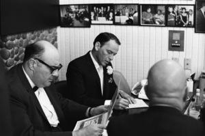 Frank Sinatra and the rabbi at Sammy Davis Jr.