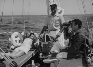 "Humphrey Bogart with his friends on his yacht ""Santana"" 1952 © 1978 Sid Avery - Image 0015_0005"