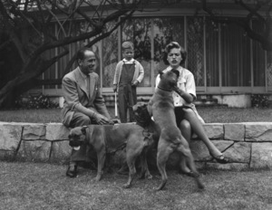 Humphrey Bogart, Lauren Bacall, and their son, Stephen, with their pet boxers, Harvey, George, and Baby, at home in Los Angeles, CA 1952 © 1978 Sid Avery - Image 0015_0006