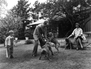 Humphrey Bogart, Lauren Bacall, and their son, Stephen, with their pet boxers, Harvey, George and Baby, at home in Los Angeles, CA1952 © 1978 Sid Avery - Image 0015_0010