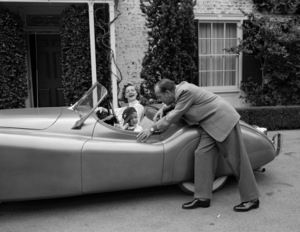 Humphrey Bogart, Lauren Bacall and their son, Stephen in their Jaguar XK 120 at home in Los Angeles 1952 © 1978 Sid Avery - Image 0015_0012