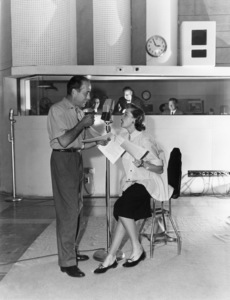 Humphrey Bogart and Lauren Bacall at a radio station1952© 1978 Sid Avery - Image 0015_0022