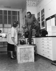 Humphrey Bogart, Lauren Bacall and their son, Stephen, in their kitchen at home in Los Angeles1952© 1978 Sid Avery - Image 0015_0029