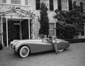 Humphrey Bogart, Lauren Bacall and their son, Stephen, in their Jaguar XK 120 at home in Los Angeles, CA1952© 1978 Sid Avery - Image 0015_0048