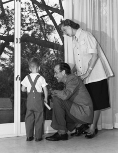 Humphrey Bogart at home with his son, Stephen, and wife Lauren Bacall1952© 1978 Sid Avery - Image 0015_0057
