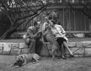Humphrey Bogart, Lauren Bacall and their son Stephen with their pet boxers at home in Los Angeles, CA1952 © 1978 Sid Avery - Image 0015_0070