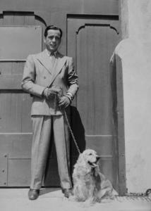 Humphrey Bogart with his dog, 1945.MPTV - Image 0015_0097