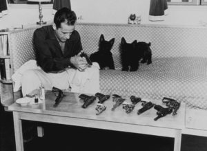 Humphrey Bogart with his pet scottish terriers and gun collection at home, circa 1946.MPTV - Image 0015_0098