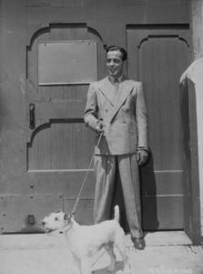 Humphrey Bogart with his dog, 1945.MPTV - Image 0015_0127