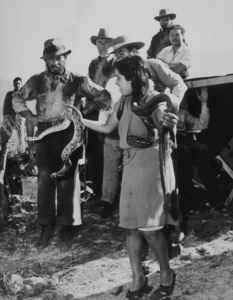 """Humphrey Bogart and a rattlesnake handler on the set of """"Treaure of the Sierra Madre,"""" 1948 Warner. Bros.Photo by Mac JulianMPTV - Image 0015_1027"""