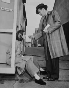 """Humphrey Bogart visiting Lauren Bacall on the set of """"Confidential Agent,"""" 1945.Photo by Lloyd MacLeanMPTV - Image 0015_1030"""