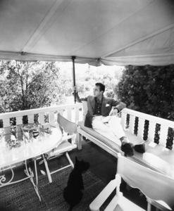 Humphrey Bogart at home with his dog Sluggy1944 - Image 0015_1043