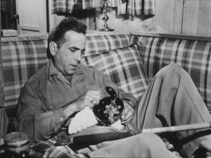 Humphrey Bogart repairing his fishing tackle, 1944.MPTV - Image 0015_1049