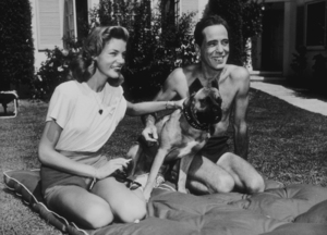 Humphrey Bogart and Lauren Bacall with their pet boxer at their Benedict Canyon home, CA, 1947.MPTV - Image 0015_1092