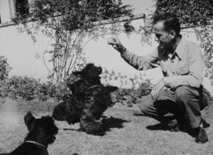 Humphrey Bogart with his dogs, circa 1944.MPTV - Image 0015_1101