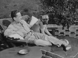 Humphrey Bogart with his pet boxer, Harvey, at his Benedict Canyon home, CA, 1948.MPTV - Image 0015_1103