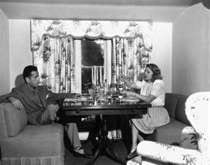 Humphrey Bogart at home with wife Mayo Methotcirca 1944 - Image 0015_1257