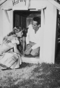 Humphrey Bogart and Lauren Bacall with their pet boxer, Harvey, at their Benedict Canyon home, CA, 1948.MPTV - Image 0015_1288