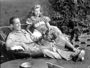 Humphrey Bogart and Lauren Bacall with their pet boxer, Harvey, at their Benedict Canyon home, CA, 1948.MPTV - Image 0015_1289