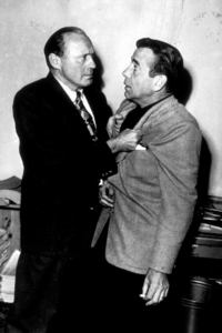 "Humphrey Bogart and Jack Benny behind the scenes of ""The Jack Benny Show,"" circa 1955.(Bogart"