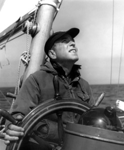 "Humphrey BogartAt the wheel of ""Santana"" 1954Copyright John Swope Trust / MPTV - Image 0015_1441"