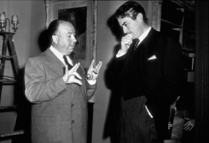 """Alfred Hitchcock and Gregory Peckon the set of """"The Paradine Case,"""" 1947.Photo by Selzwick - Image 0017_0370"""