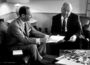 """Alfred Hitchcock with """"North By Northwest""""writer Ernest Lemman, c. 1959. © 1978 Lou Jacobs - Image 0017_0387"""