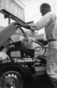Steve McQueen & his 1957 XKSS Jaguar ,with his mechanic at Grand Prix Motors in Hollywood 1960 © 1986 Sid Avery - Image 0019_0009