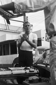 Steve McQueen talking to his 1957 XK-SS Jaguar mechanic at Grand Prix Motors on Melrose Avenue in Los Angeles1960© 1978 Sid Avery - Image 0019_0016