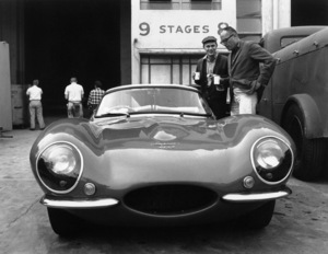 Steve McQueen examining his 1957 Jaguar XKSS with director John Sturgess on the lot of Goldwyn Studio in Hollywood1960© 1978 Sid Avery - Image 0019_0080