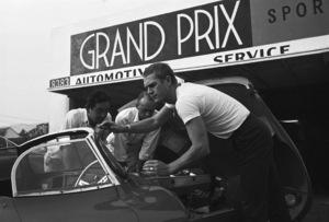 Steve McQueen talking to his 1957 XK-SS Jaguar mechanic at Grand Prix Motors on Melrose Avenue in Los Angeles1960© 1978 Sid Avery - Image 0019_0820