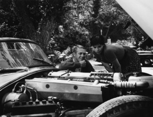 Steve McQueen with his wife Neile at their Laurel Canyon home admiring his 1957 XK-SS Jaguar1958© 1978 Gene Trindl - Image 0019_0834