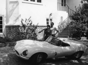 Steve McQueen with his wife Neile at their Laurel Canyon home admiring his 1957 XK-SS Jaguar1958© 1978 Gene Trindl - Image 0019_0835