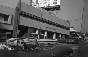 Steve McQueen in his 1957 XKSS Jaguar Los Angeles CA 1960 © 1978 Sid Avery  - Image 0019_0876